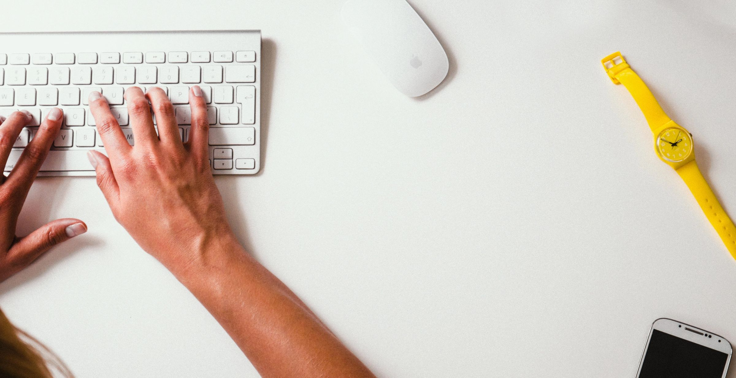 Typing on a keyboard to showcase editing a website in a blog from SkyCastle Production Atlanta Web Design studio
