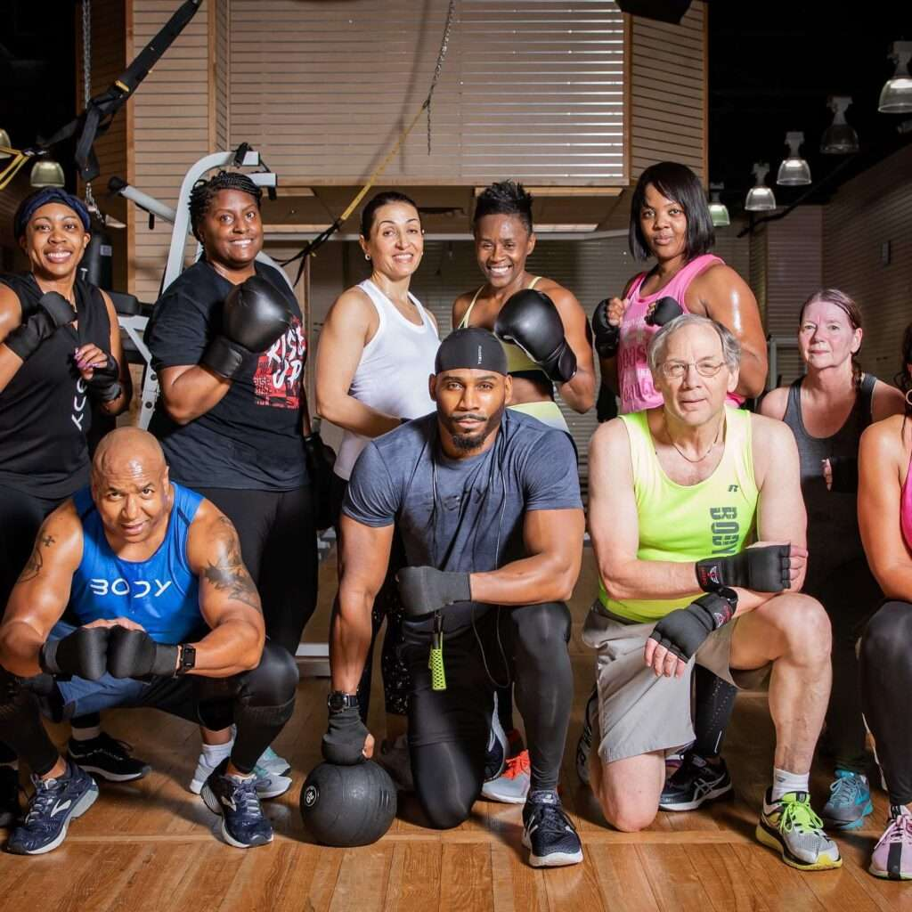 Photo of members of a Gym with their personal trainer taken by SkyCastle Productions Photographer William Twitty